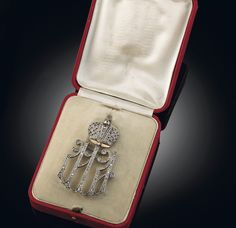 MAID OF HONOUR CIPHER OF THE RUSSIAN IMPERIAL COURT. In the form of the Cyrillic initials 'MA' for Dowager Empress Maria Feodorovna and Empress Alexandra Feodorovna, set with rose-cut diamonds mounted on silver-topped gold, surmounted by a rose-cut diamond-set crown. By Carl Blank, St. Petersburg, 1913. Delivered June 6th in the same year, price 620 roubles. Baroness Maria 'Marouisia' Langhoff was appointed maid of honour on 22 July 1913.