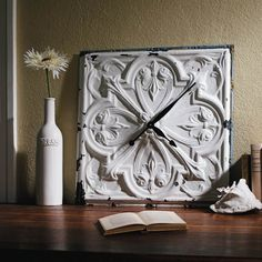 Salvaged Tin Clock -- I have an extra tin ceiling tile I could paint and make a clock. I like this idea a lot!!!