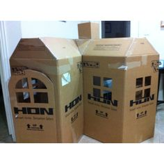 My cardboard playhouse (mansion!) hehe. I'm debating whether I want to paint it or not...Summer Project?  :)