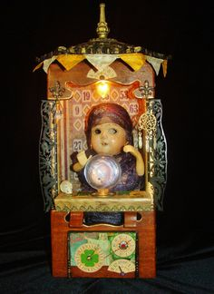 """The Fortune Teller 2014 mixed media assemblage by Dianne Hoffman 16"""" tall x 7"""" wide x 6"""" deep On exhibit at Arc's Project Gallery 5/7-6/21, 2014: http://www.arc-sf.com/circus-freaks--sideshows.html For additional views see the Flickr set here: https://www.flickr.com/photos/collagelodge/sets/72157644441415572/"""
