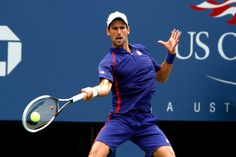 Novak Djokovic (SRB)[2] in action against Julien Benneteau (FRA)[31] in the third round of the US Open. - Philip Hall/USTA
