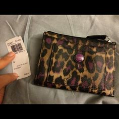 Nwt Coach ocelot coin purse/ wallet Never used super cute ocelot coin purse/ wallet Coach Bags Wallets