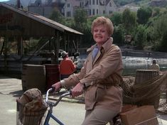 """Jessica on Her Iconic Bicycle in Cabot Cove. """"Murder, She Wrote"""" TV Show on CBS - charming author Jessica Fletcher (Angela Lansbury). Angela Lansbury, Cabot Cove, Hudson Taylor, Famous Serial Killers, Mystery Show, Murder, Custom Funko, Prime Time, Cozy Mysteries"""