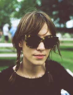 bb734cd491 Alexa Chung braided pigtails with animal print sunglasses