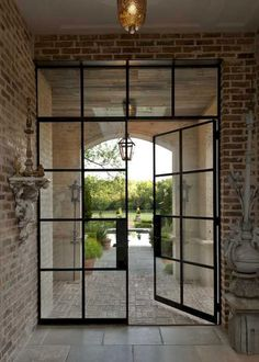 French doors, patio doors, and sliding glass doors all add such ambience to any property that you would hardly want to cover them up. In fact French doors are too perfect and allows in so much of… Double French Doors, French Doors Patio, French Patio, French Windows, Black French Doors, Industrial Door, Industrial Interiors, Vintage Industrial, Industrial Furniture