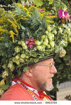 Morris dancer wearing a flower covered hat, Faversham Hop Festival, Kent, UK by Helmut Konrad Watson, via ShutterStock