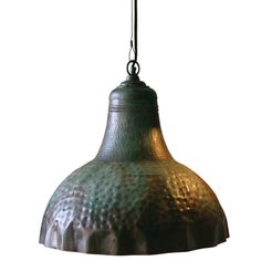 """For those hooked on all things industrial, this Distressed Metal Hammered Pendant is loaded with industrial style! The 20""""-wide, cord-hung pendant throws a generous amount of light onto any surface and would make a perfect addition..."""