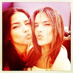 Adriana Lima and Alessandra Ambrosio blew kisses to the camera during a Victorias Secret photo shoot.