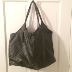 Black Leather Tote This black, woven leather bag is slouchy and fits a great amount of items. Great for quick overnight trips or for running errands. It has a zip inside pocket and closes with one snap. Straps long enough to toss on your shoulder. Great condition. H&M Bags Shoulder Bags