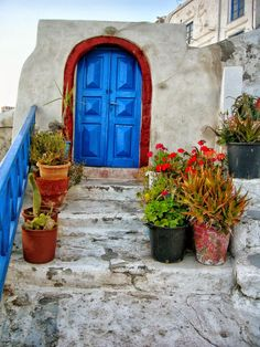 It only takes a few potplants and a bright front door....and there you are, how lovely.