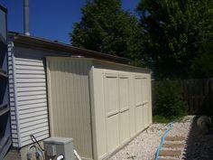 Storage shed lean to behind garage