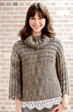 The Misty Morning Knit Sweater Pattern combines two very important cold weather items: a sweater and a cowl. This stylish sweater keeps you warm while also making you stand out against the gray of rainy days with its unique design.
