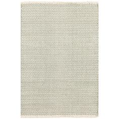 The Dash & Albert Herringbone rug's classic design delivers a fresh statement. Mesmerizing and modern, this floor covering features an ocean green and cream geometric print. Woven cotton; Professional cleaning recommended; Rug pad recommended; 2ft W x 3ft H; 2.5ft W x 8ft H; 4ft W x 6ft H; 2.5ft W x 12ft H; 6ft W x 9ft H; 8ft W x 10ft H; 9ft W x 12ft H