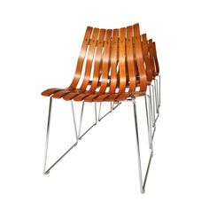 Four Teak Scandia Dining Chairs Designed by Hans BrattrudFour Teak Scandia Dining Chairs Designed by Hans Brattrud - A rare original mid-century set of 4 teak Scandia dining chairs, designed by Hans Brattrud for Hove Mobler.