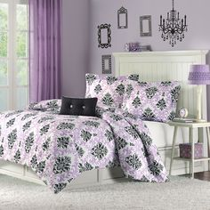 Katelyn is the perfect way to add color and fashion to your bedroom.  This comforter mini-set brings in a great combination of purple with black to create this fun damask pattern.  The pattern is printed on super soft micro-fiber and reverses to a black colored soft micro-fiber fabric.  One decorative pillow is also included in the set. The comforter will fit a Twin or Twin XL size bed
