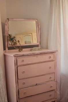 love this old pink color...I have 2 dressers like this. They were my grandma's...painted for her by my grandfather.