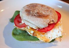 'Break the Rules' egg muffin sandwich.... Egg.. Hummus .. Spinach .. Tomatoes