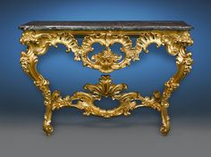 This outstanding Louis XV-period giltwood console table is lavishly carved with the naturalistic, voluptuous motifs. Would look great in the Hall