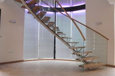 Helical staircase with a centre pole in a domestic situation #helical #staircase #pole #glass #oak