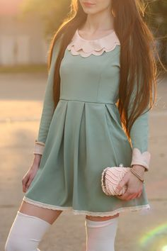 Very cute mint green dress with a very cute collar to match. Complimented with white stockings.