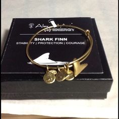 Authentic Alex & Ani Gold Shark Fin Charm Bracelet Authentic Alex & Ani Gold Shark Fin Charm Bracelet new with tag and card. A black box is provided. Alex & Ani Jewelry Bracelets