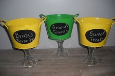 Candy bar idea  Do it with the glass vases but add the bride and groom's favorites:)