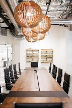 A custom made conference table beautifully done by Helvey design.