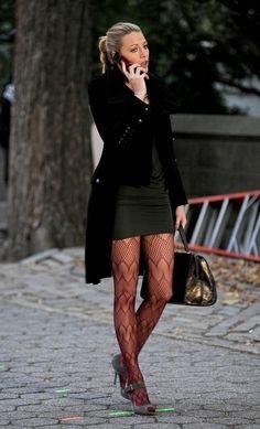 NYC fashion: black tights, black heels, black dress, black coat