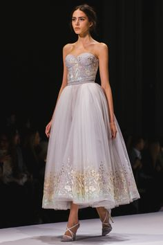 Ooh I love this shape, the length, the soft lavender, the floral embellishments and THOSE HEELS! hehe.