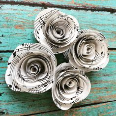 Working on some flowers for @themodernwhittler. Loving these rolled sheet music flowers #paperflower #paperart #papercraft #sheetmusic #rolledflowers #weddingflowers #etsyshop #etsyseller #smallbusiness #mompreneur #musicnotes #music by _everydayinc