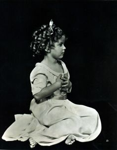1930s ~ Shirley Temple ~ an extremely talented little girl who thrilled the world with her acting, singing & dancing. She was the cutest little thing on the screen in her days at Hollywood, with her bouncing curls, cheeky dimpled face, and melt-your-heart-smile. She danced, sang, & tapped her way into people's hearts. Beautiful child-star.