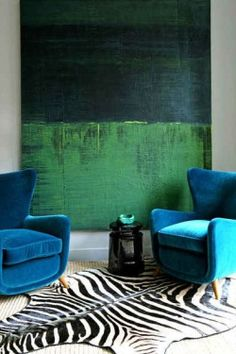 mid-centuryhomestyle: Blue and green must certainly be seen! Especially with a zebra hide rug.