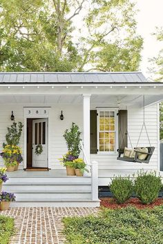 """Always make room for porch conversations,"" says Gibson. He widened and deepened the front stoop, tu... - Laurey W. Glenn"