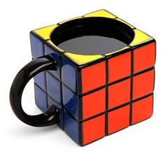Anyone can drink out of a regular mug. But you have to be different. You need a mug that shows off your old school geek cred. Like this one - fashioned to look like a solved Rubik's Cube!