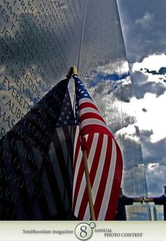 """Photo of the Day - December 30, 2011: """"Finding Grandpa's name on the Vietnam Memorial."""" Taken by Hayley Metro (Grand Island, NY). Photographed July 2009, Washington, DC."""