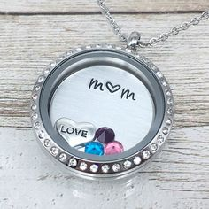 Moms are the best! Always making sure we are loved and cared for, putting our needs in front of hers. Make sure she knows how special she is with this beautiful locket, personalized just for her #momnecklace #mothersdaygift #birthstonenecklace #newmomgift #momlocket #floatinglocket #personalizedjewelry #handstampedjewelry #mothersnecklace #kidsbirthstonesnecklace #pushgift #mumnecklace #floatingcharmnecklace #giftsformom #giftfromchildren