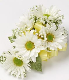 This all daisy corsage is a great staple in white but also comes in yellow lavender and green!