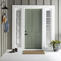 Magnolia's Sir Drake Exterior Paint makes for a welcoming front door. Green Exterior Paints, Exterior Gris, Exterior Gray Paint, Exterior Door Colors, Front Door Paint Colors, Painted Front Doors, House Paint Exterior, Paint Colors For Home, Gray Exterior Houses