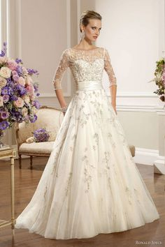 A-line lace bridal gown with 3/4 sleeves