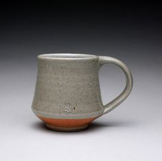 handmade pottery mug, ceramic cup, teacup with green celadon and orange shino glazes via Etsy
