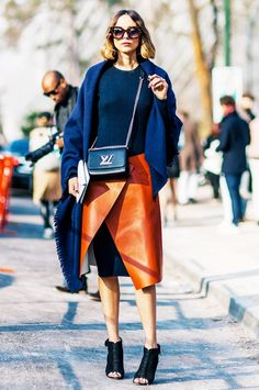 A knit dress is worn with a leather slit skirt, a blue shawl, a mini bag, and peep-toe heels