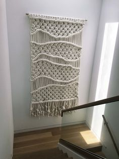 """EXTRA LARGE MACRAME OVERSIZED FIBER ART WALL HANGING MADE FROM MEGA CHUNKY CORD. KNOTTED IN A RELAXED ORGANIC STYLE THIS PIECE ADDS DIMENSIONS AND INTEREST TO ANY SPACE. DIMENSIONS"""" 5' WIDE X 9' HIGH PRICING FOR THIS DESIGN: CLICK HERE - FOR CUSTOM SIZE PRICING OR TO PLACE AN ORDER PLEASE USE THE CONTACT FORM"""
