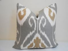 Gorgeous Kravet ikat Pillow cover. The colors include gray, brown and ivory . It is printed on 100% linen fabric that has heavy duty durability.