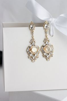 Beautiful new Crystal Bridal earrings with hand set Swarovski Rhinestone, and Vintage USA made filigree. These are gorgeous and will…