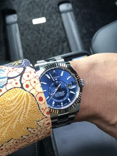 Under direct sunlight, the blue dial of Rolex Sky Dweller really shines its beauty! Pictured with Indonesian Cirebon batik shirt ❤️