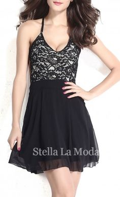 With a lace design and open back, this skater dress is nothing short of sexy. Black lace with a nude illusion top, open back with crisscross spaghetti straps. Double layers skirt in chiffon with side pockets and back zipper. Try yours with a pair of strappy heels and a sparkling clutch for an instant dance floor-ready look.