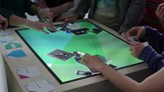 multitouch table - Using a series of papers in which it was printed a fiducial marker and a title on the item you require. Them on the surface opens up a context menu multitouch able to scroll and move the windows to your liking. Interactive Table, Open Up, Marker, Surface, Menu, Windows, Printed, Menu Board Design, Markers