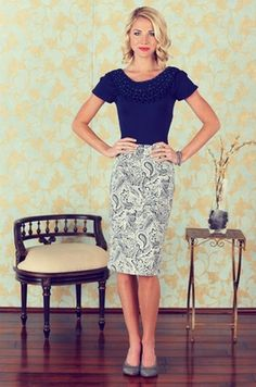 The Print Pencil Skirt is simply stunning to say the least. The fit will definitely compliment your gorgeous figure. Choose from a beautiful pink and grey lace print, and/or an eye-catching cream and navy paisley print.