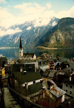 the cutest little town. Hallstatt, Austria I like Austria because of the high mountains and the houses are right there.!