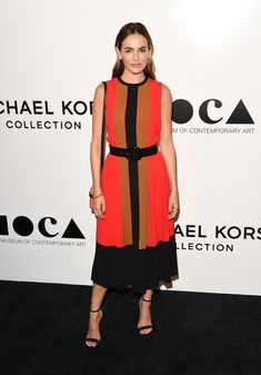 Camilla Belle chose a rich fall palette for the Michael Kors Presents The Museum of Contemporary Art's Distinguished Women in the Arts Luncheon. The pleated colorblocked dress (by Michael Kors, naturally) was chic and refined but still wowed thanks to the bright pop of color on the black carpet.